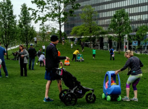 Kids and parents enjoyed ride on toys on the green