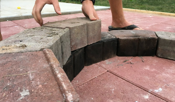Lay second ring of DIY fire pit with small gap between each block