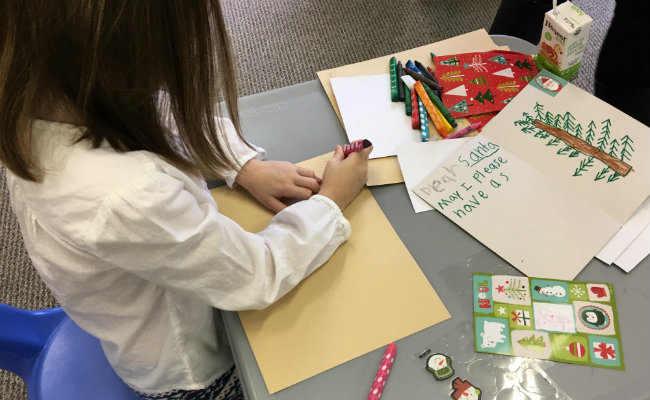 Trace letters to work on fine motor skills