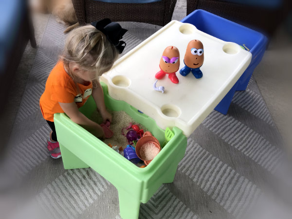 Use Simplay3 In & Out Activity Table to contain sensory materials