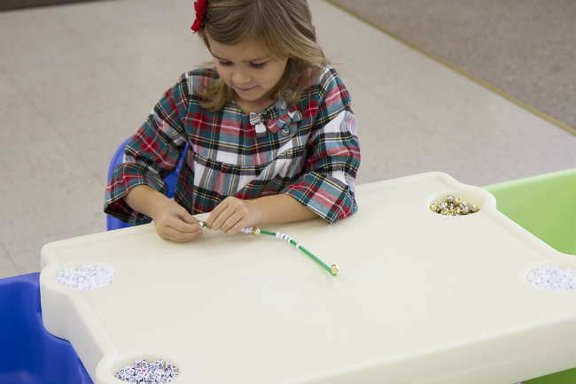 Work on fine motor skills and much more putting beads on the ornament